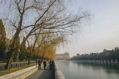 Tourist walking near the Forbidden City. Tourist walking a long the lake near the Forbidden Stock Photos