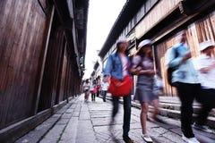 Tourist walking on old street Royalty Free Stock Photo