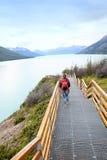 Tourist walking on Perito Moreno footbridge Royalty Free Stock Photos