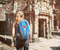 Tourist walking into the Preah Khan temple in Angkor, Cambodia Stock Photos