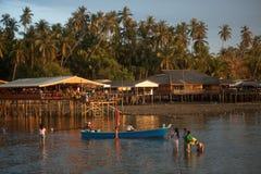 Tourist walking relax in the sea near Koh Phitak island. Royalty Free Stock Photo
