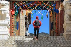 Tourist walking at SongZanLin Temple in Shangri-La China. Tourist walk around at SongZanLin Temple in Shangri-La Zhongdian YunNan China royalty free stock image