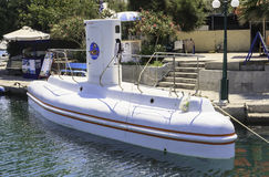 Tourist walking submarine waterfront resort of Faliraki. Rhodes Royalty Free Stock Images