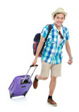 Tourist walking with suitcase Stock Photography