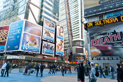 Tourist walking in times square Royalty Free Stock Photo