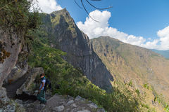 Tourist walking to Inca Bridge at Machu Picchu, Peru Stock Photo