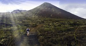 Tourist walking to Volcano La Corona - Lanzarote, Canary Islands, Spain stock images