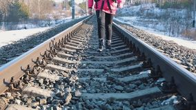 Tourist walking on train tracks stock video footage