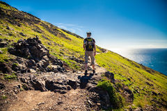 Tourist walking on the trekking path Royalty Free Stock Image