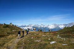 Tourist walking in trekking trail with Beautiful view in Nendaz Royalty Free Stock Photography