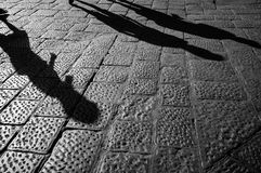 Tourist walking up the cobblestone pavement of Florence Stock Images