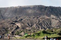 Tourist walking up to Bromo crater Stock Image