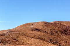 tourist walking up the Uluru, ayers Rock, the Red Center of Australia, Australia royalty free stock images