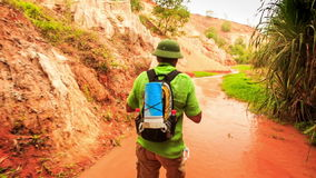 Tourist Walks along Fairy-Stream by Rocks Photos Plants stock video