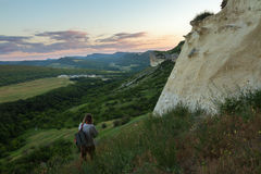 Tourist walks along the slope of the Cave city Bakla in Bakhchysarai Raion Stock Image