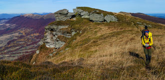 Tourist walks in autumn mountain landscape Royalty Free Stock Photography
