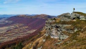 Tourist walks in autumn mountain landscape Stock Photography