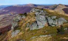 Tourist walks in autumn mountain landscape Stock Photo