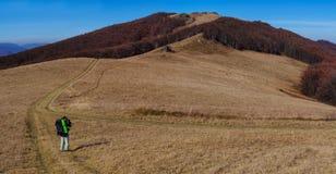 Tourist walks in autumn mountain landscape Stock Images