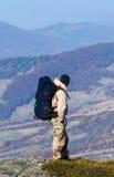 Tourist walks in autumn mountain landscape Stock Image