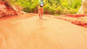 Tourist Walks Barefoot along Fairy-Stream Shallow Water stock video footage