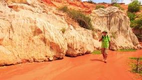 Tourist Walks Barefoot along Fairy-Stream Shallow Water stock footage