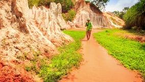 Tourist Walks Barefoot Photos in Fairy-Stream Shallow Water stock video