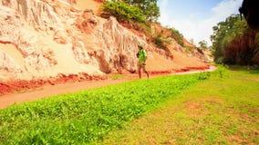 Tourist Walks Barefoot Photos in Fairy-Stream Shallow Water stock video footage