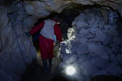Tourist walks inside the cooperative mine Stock Photo