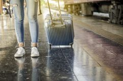 A tourist walks a luggage at the train station. Waiting for the train, Self-guided travel concept, Summer vacation in Asia stock photos