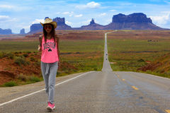 Tourist walks in the Monument valley Royalty Free Stock Images