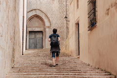 Tourist walks in the old city Stock Photos