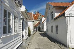 Tourist walks by the street of the old town in Stavanger, Norway. Stock Photos
