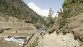 Tourist walks trekking in Himalaya, Manaslu area, Nepal. Tourist walks trekking in Himalaya, Manaslu area, Nepal stock video footage