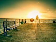 Tourist watch sunrise outside at beach bridge royalty free stock images