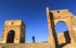 A tourist watches Merenid Fortress in Fes, Morocco Royalty Free Stock Photography