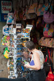 Tourist watches postcards, Saigon Royalty Free Stock Photography