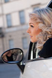 Tourist watches something from her car Royalty Free Stock Photo