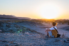 Tourist watching the stunning view of barren valley and mountains in the Namib desert, among the most important travel destination. In Namibia, Africa royalty free stock photos