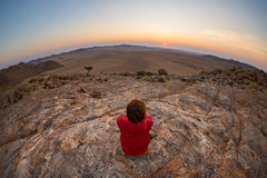 Tourist watching the stunning view of barren valley in the Namib desert, among the most important travel destination in Namibia, A Royalty Free Stock Images