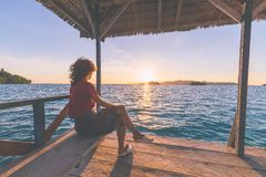 Tourist watching sunrise in resort, marsala toned image Royalty Free Stock Photo