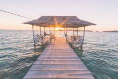Tourist watching sunrise in resort, marsala toned image Royalty Free Stock Photography