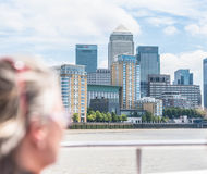 Tourist watching towards Canary wharf financial district stock photography