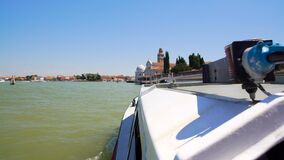 Tourist water bus moving towards Venice church, sightseeing tour for travellers. Stock footage stock video