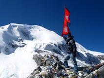 Tourist wavin Nepali Flag Stock Image