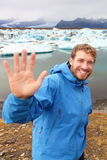 Tourist waving hand by Jokulsarlon on Iceland Royalty Free Stock Photos