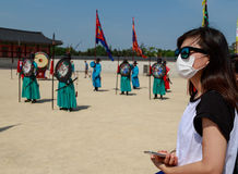 A tourist wearing a mask for protect from Mers virus in South Ko Stock Photography
