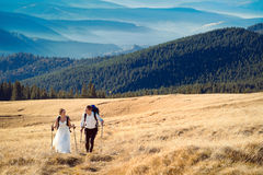 Tourist wedding couple traveling in the mountains. Honeymoon at Alps Stock Photography