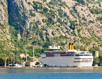 Tourist white cruise sea liner is sailing on the mountain backgr Royalty Free Stock Photo