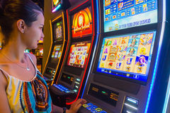 Tourist winning at slot machines Royalty Free Stock Image